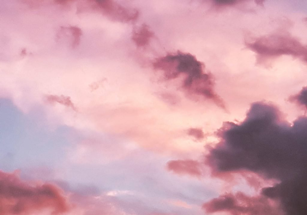 Clouds in the sky with a pink hue.