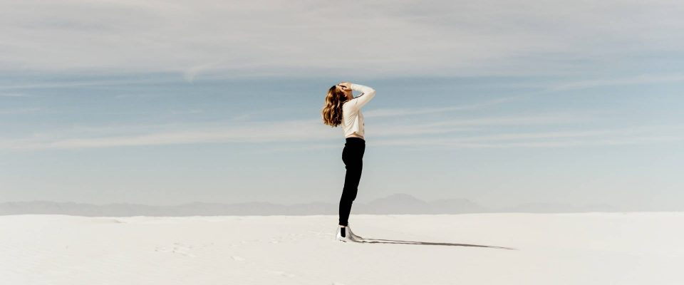 God's Goodness - Person standing in desert.